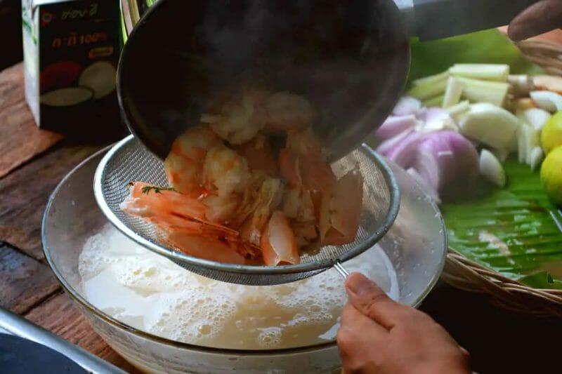straining tom yum shrimp or prawn
